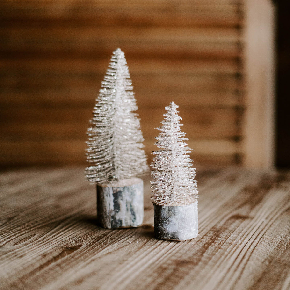 Small gold foxtail trees with a silver metal base in 3 different sizes