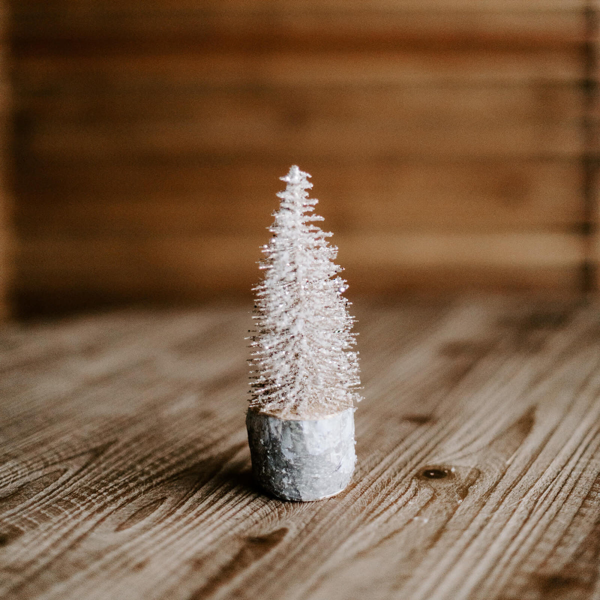 Small gold foxtail trees with a silver metal base, 7 inches tall