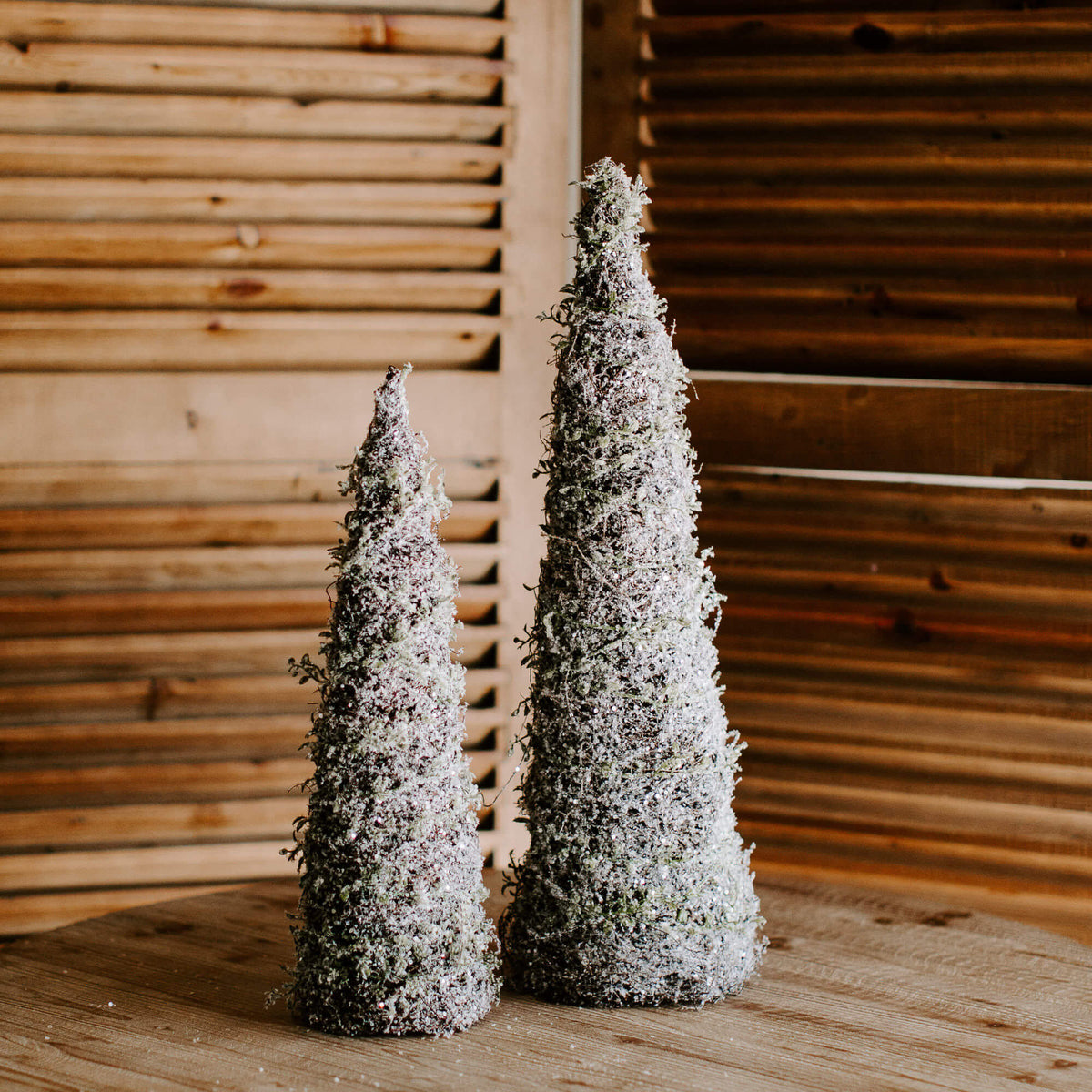 Cone shaped trees wrapped in faux icy vine