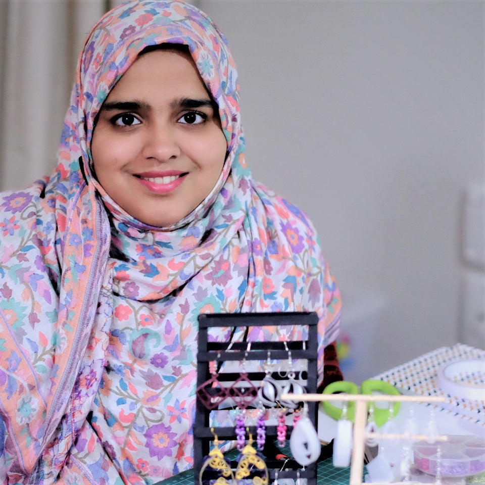 A picture of Juwairiyah Alam with her jewellery.  She is wearing a pink and purple colourful hijab.