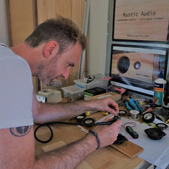 James making a stereo with all the parts and his sign above