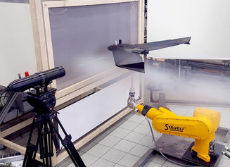 A drone tested with a robotic arm in a wind tunnel