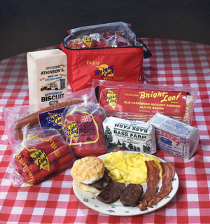 The North Carolina Iconic Brands Sampler (1-Hot Dog, 1-Red Hot, 1-Bacon, 1- Loop Smoked Sausage, 1-Bass Farm, 1-Neeses, 1-Biscuit Mix)