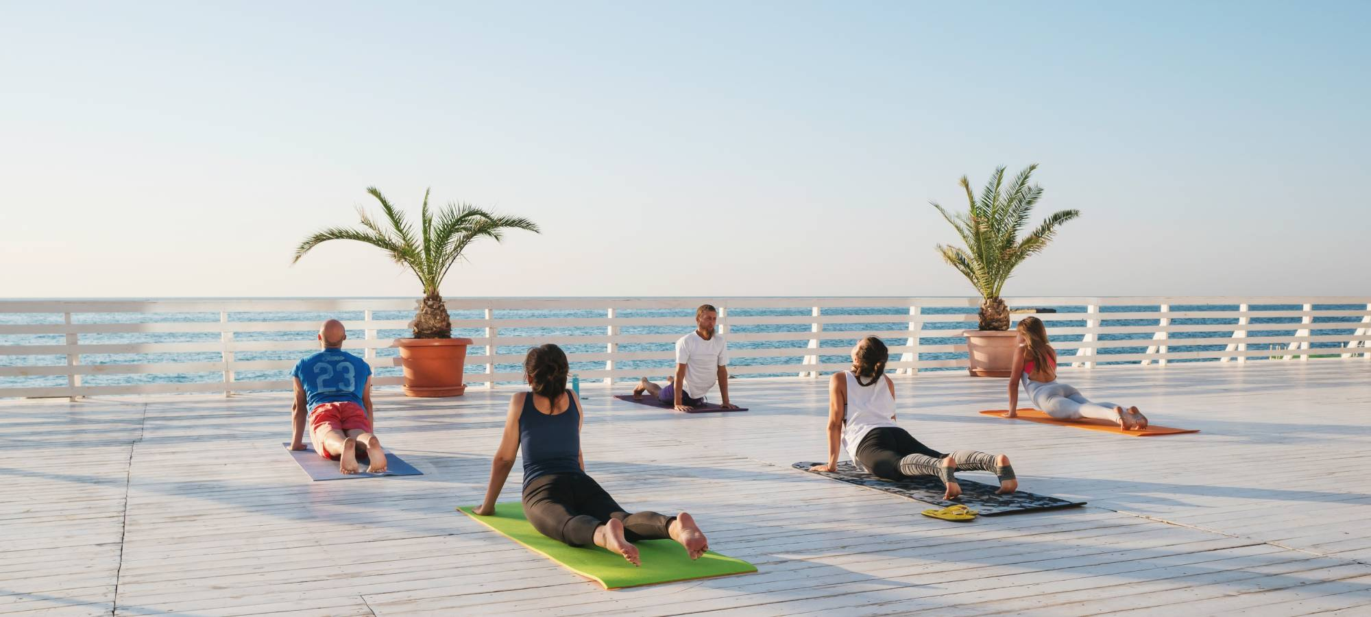 group yoga retreat overlooking water
