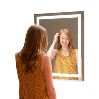 woman looking at reflection in mirror gallery