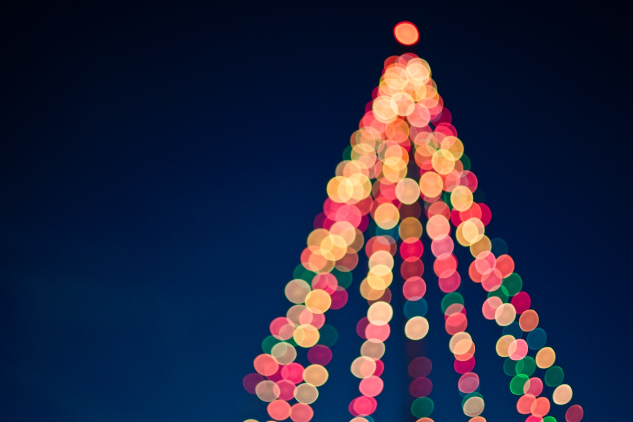 Blurred Christmas lights in a tree shape