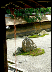 japanese loop style rain chain hanging in zen garden