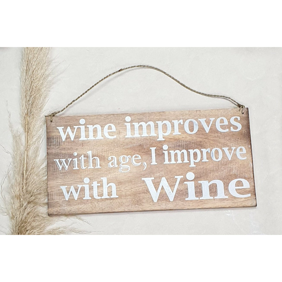 """Wine improves with age, I improve - wooden sign"