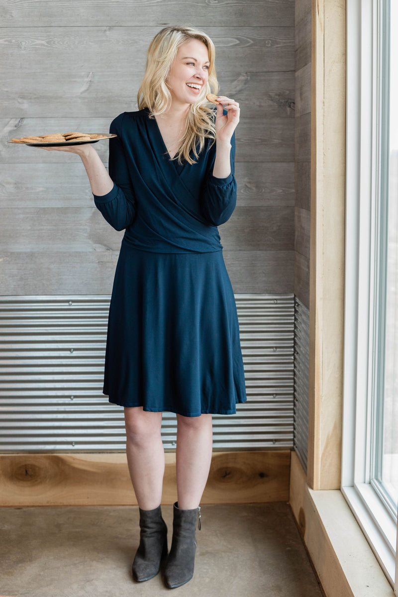 Faux wrap dress with 3/4 sleeves is flattering and comfortable.