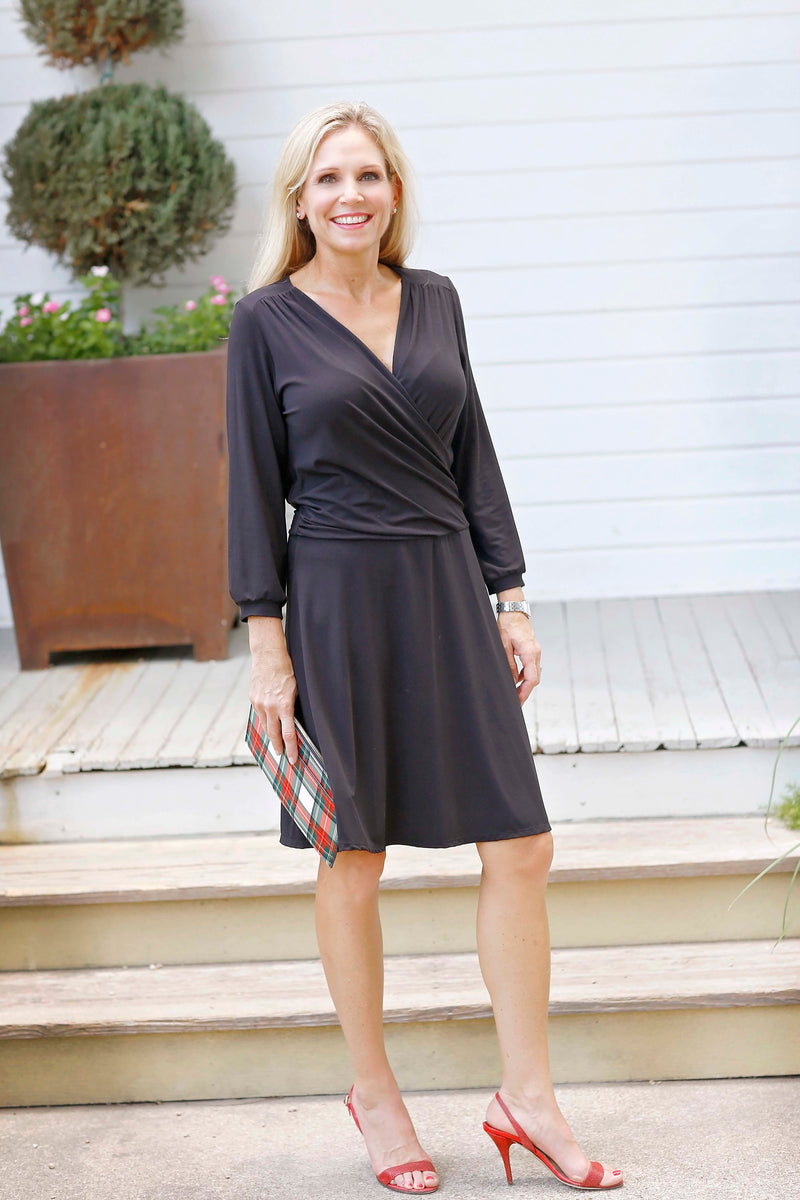 Faux wrap dress in black is figure flattering and comfortable.