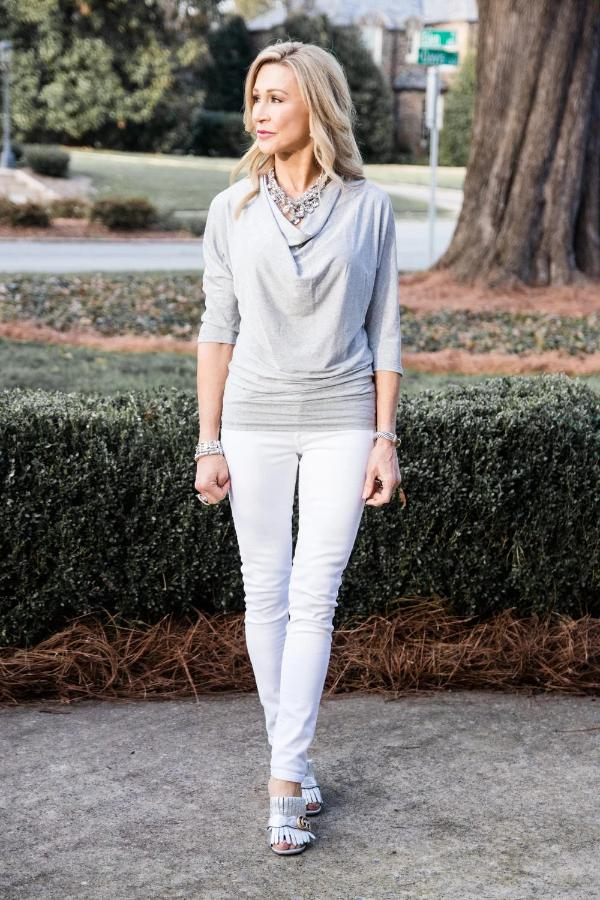 Women's silver top with flattering cowl neck and three-quarter length sleeves.