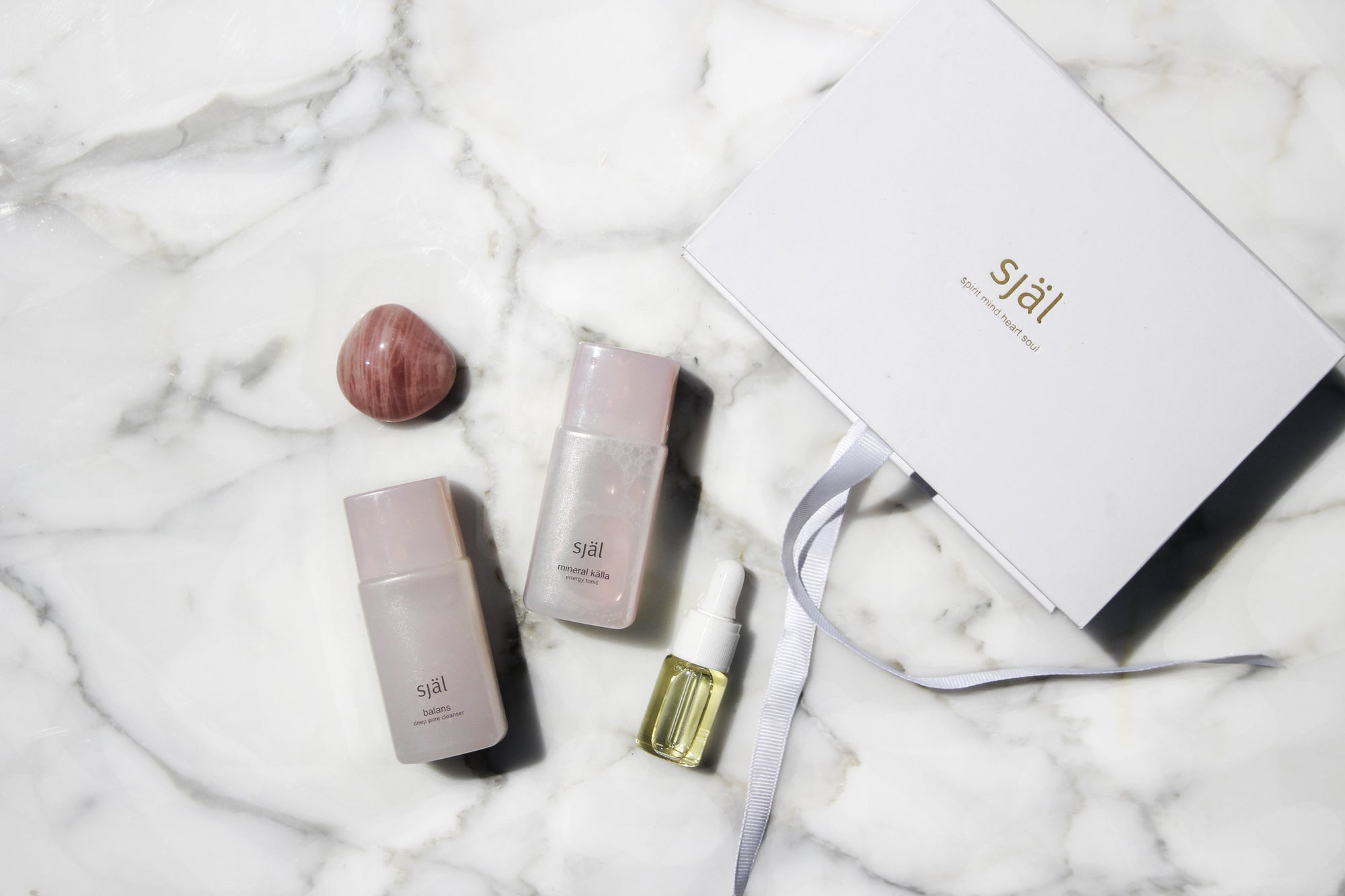 Receive a complimentary Rose Gold Cleansing Revitalizing Set from Själ Skincare.