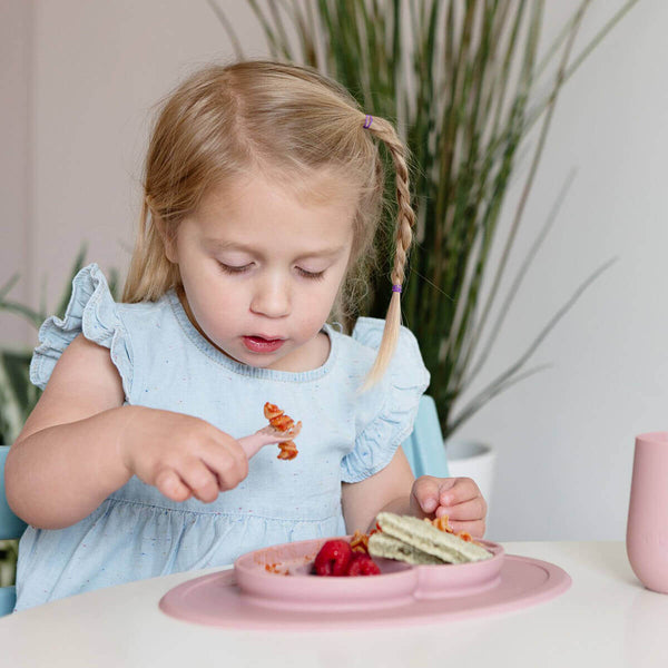 Mini Feeding Set by ezpz / The Original All-In-One Silicone Plates & Placemats that Stick to the Table