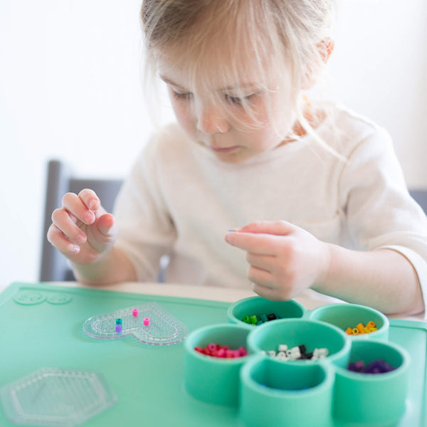Play Mat by ezpz / The Original All-In-One Silicone Plates & Placemats that Stick to the Table