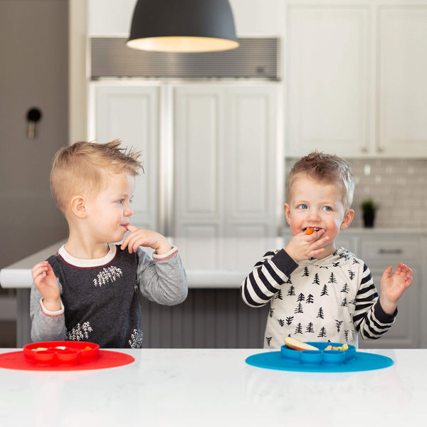 Sesame Street® Elmo Mat by ezpz / The Original All-In-One Silicone Plates & Placemats that Stick to the Table