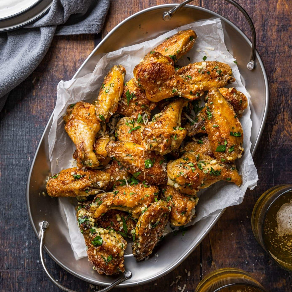 A bowl of garlic parmesan chicken wings