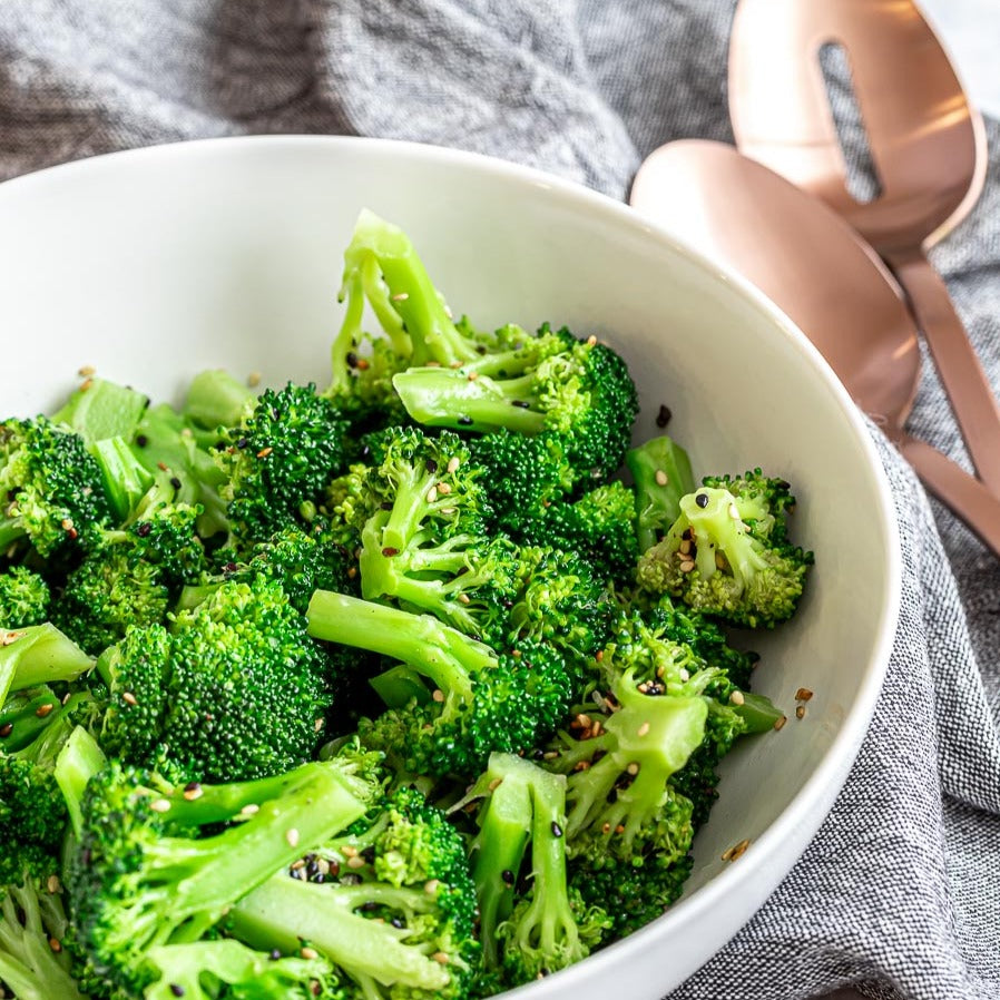 Bowl of broccoli with sesame seeds