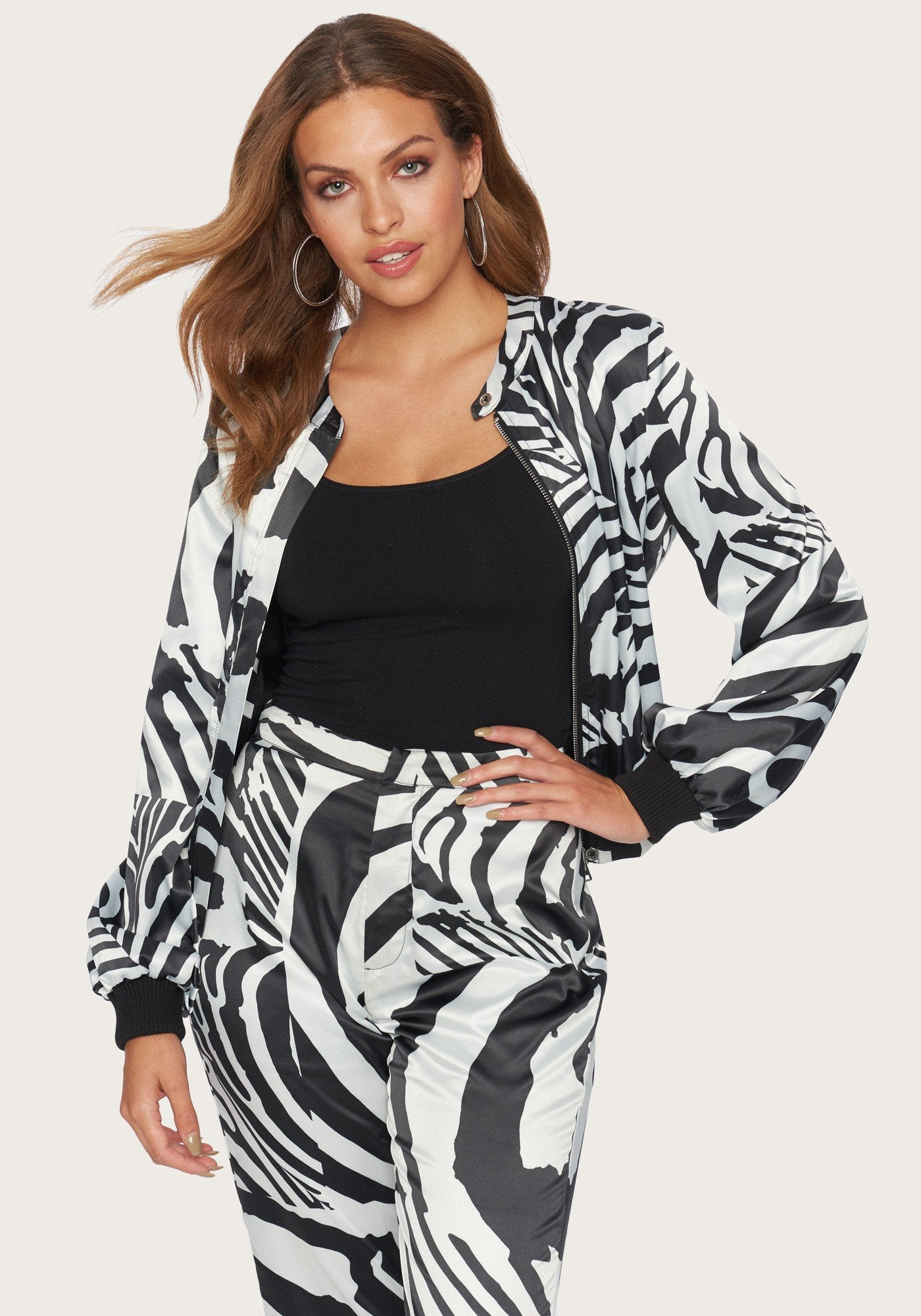 Image of Bebe Women's Print Charmeuse Bomber Jacket, Size Medium in Abstract Zebra Spandex