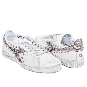 Diadora con borchie e borchiate in stile pitone game low personalizzate in stile animalier pitonate Racoon-LAB
