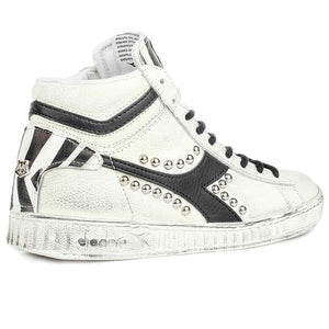 Sneakers zebrate modello diadora game high con borchie