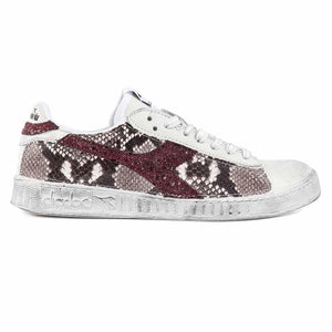 diadora game low con animalier effetto pitone e glitter bordeaux