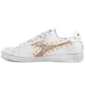 sneakers glitter e borchie marca diadora modello belite con brillantini colore oro by Racoon-LAB_INT