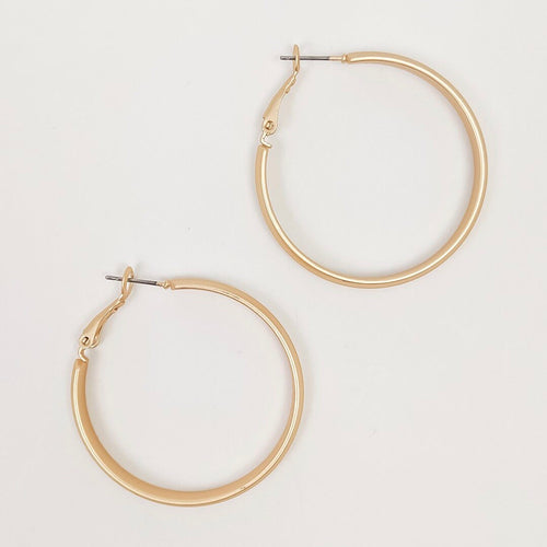 One and one half inch diameter gold brushed metal dangle hoop earrings