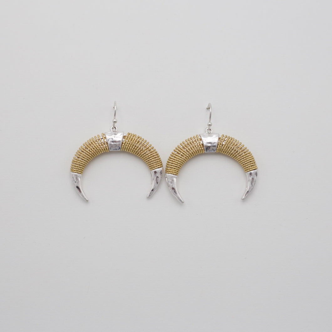 Gold and silver dangle horn earrings on gold fish hooks