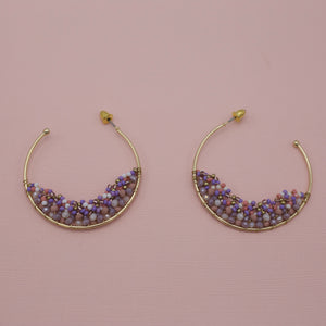 Gold hoops with half moon of lavender beads at the bottom of jewelry earrings