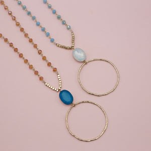Glass beads on long chain jewelry necklaces with a topaz pendant