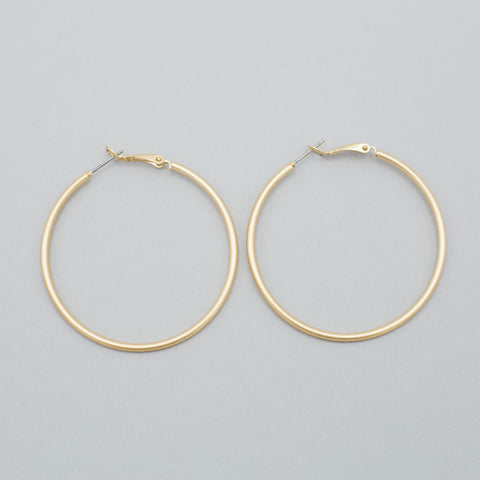 Shawna Hoop Earrings-Have a dainty pair of earrings that needs an addition to them? Then pair the Shawna Hoop Earrings for a simple statement or layered look. Hoops will never go out of style! Gold round hoop earrings. Follow us on Facebook and don't forget to take a look at our New Arrivals!-East Coast She, South Carolina