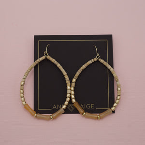 Natural brown beaded teardrop hoop earrings
