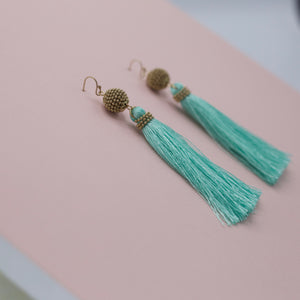 Round gold ball jewelry earrings with mint tassels