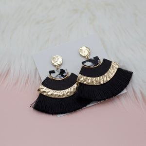Black half moon tassels attached to black and white half moon acrylic attached to small round hammered gold stud circle jewelry earrings