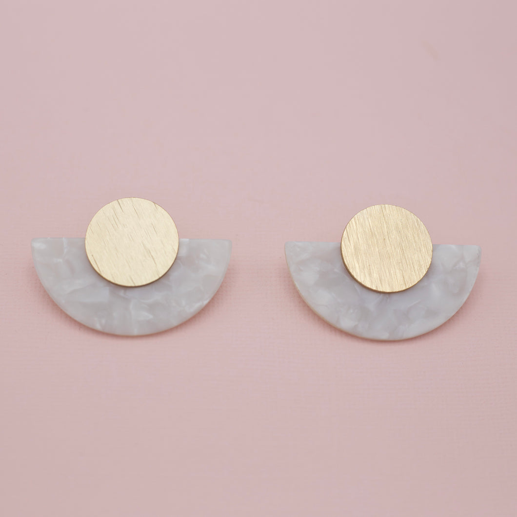 White acrylic half moons attached to matte gold round disk jewelry earrings
