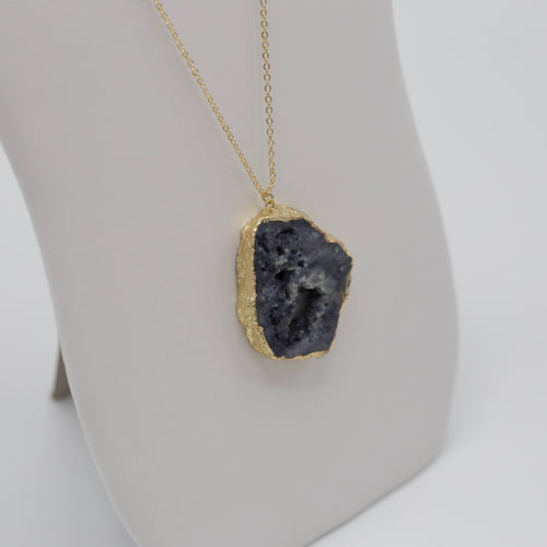 Black druzy stone pendant on long gold jewelry necklaces