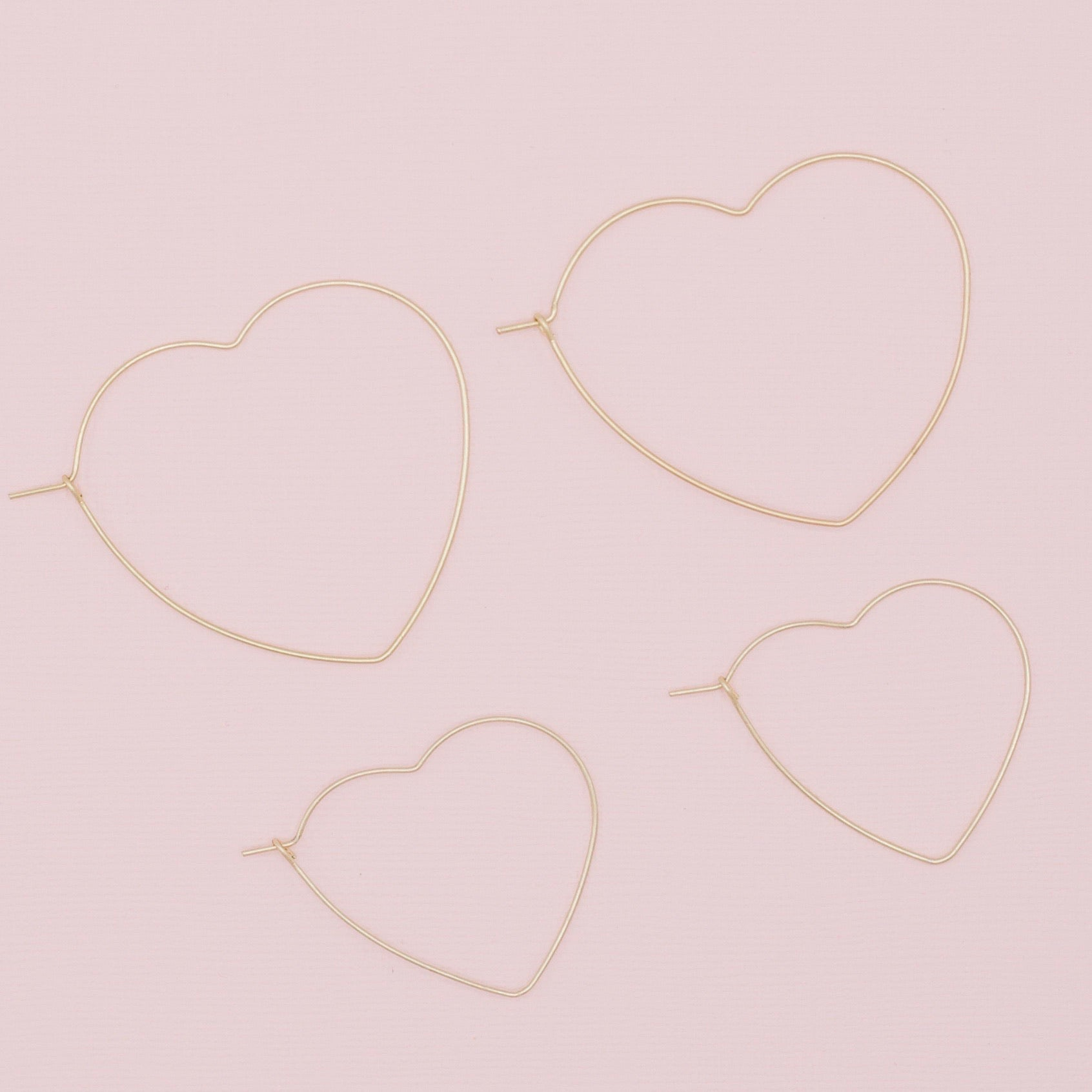 "Be Still My Heart Hoop Earrings-Be Still My Heart Hoop Earrings. One for you and one for the little one. Or give one to your bestie! Dainty heart shaped earrings that are lightweight and speak only of love. Secure fit promises carefree wear! Lightweight Gold wire Kidney shaped hooks Sizing - One size | Small 1 1/4"" Diameter, Large 1 3/4"" Diameter. -East Coast She, South Carolina"