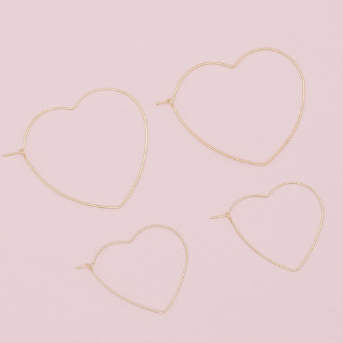 Be Still My Heart Hoop Earrings-Be Still My Heart Hoop Earrings. One for you and one for the little one. Or give one to your bestie! Dainty heart shaped earrings that are lightweight and speak only of love. Secure fit promises carefree wear! Lightweight Gold wire Kidney shaped hooks Sizing - One size | Small 1 1/4