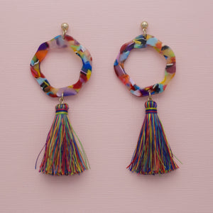 "Ada Earrings-These marbled acrylic tassel statement earrings are eye-catching with retro circles. They also have stud post backs. Wear them with your knit solid midi dress and sandals to dress-up that casual style. Marble acrylic Stud post backs Worn Gold Multi-Colored Acrylic One size | 3.5"" Length. New Arrivals! Ada Earrings.-East Coast She, South Carolina"
