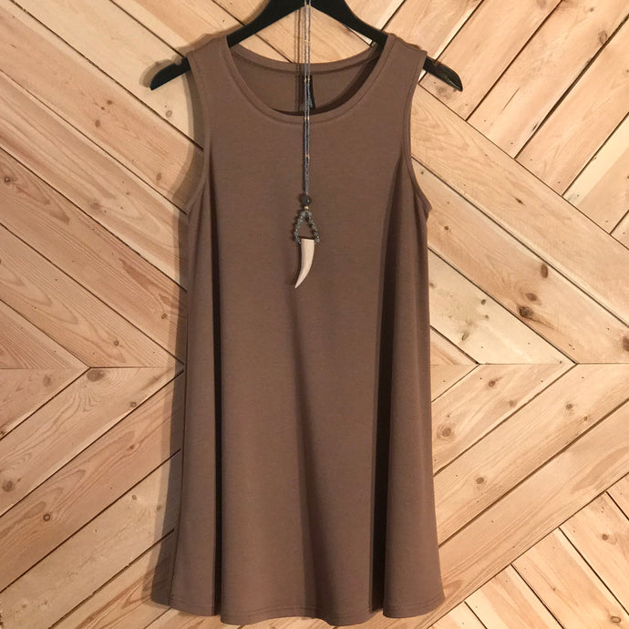 A-line style brown tank dress in small, medium and large. Sixty percent polyester, thirty-five percent rayon and five percent spandex. Styled with necklace Clara.
