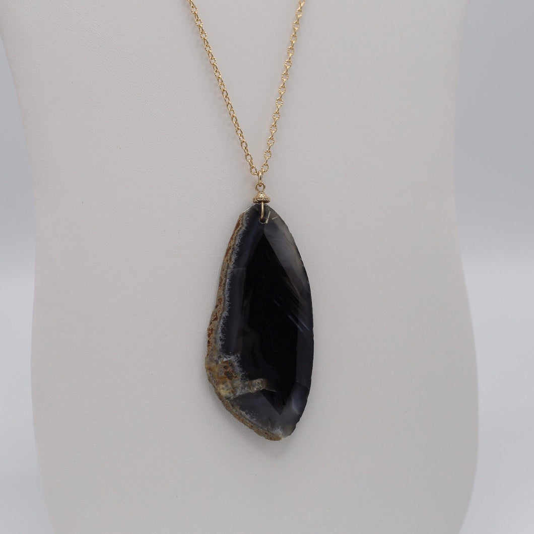 Sliced natural black agate jewelry on thirty inch long gold necklace