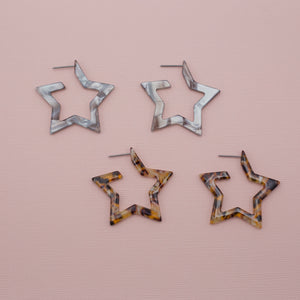One set of gray and one set of tortoise acrylic star jewelry earrings on straight post