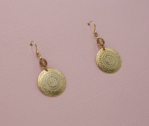 Gold disk drop jewelry earrings attached to small amber glass beads on french hooks