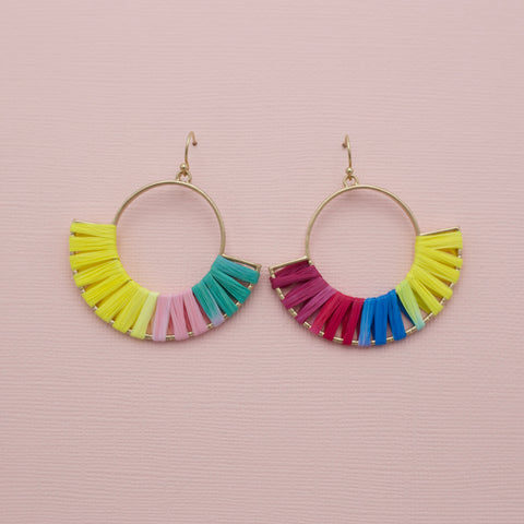 "Ally Raffia Earrings-These raffia earrings are so fun and playful! These are made with thin metal hoops and wrapped with multi-colored raffia and finished with gold fish hooks. And they are very lightweight! Multi-colored raffia. Round shaped. Fish hook. Sizing - One size | 2 1/2"" Length.-East Coast She, South Carolina"