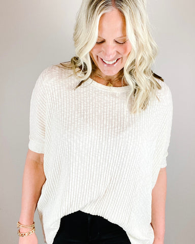 Amy Spring Knit Top-Amy Spring Knit Top The ivory Amy Spring Knit Top is perfect for those spring days that heat up and cool down. This top has a boat neck, dolman sleeves, non-sheer with a ribbed pattern. Perfect for leggings and denims! Dolman mid-length sleeves Non-sheer Ribbed pattern  Boat neckline Hi-low hem.-East Coast She, South Carolina
