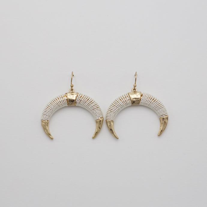 Silver and gold dangle horn earrings on gold fish hooks