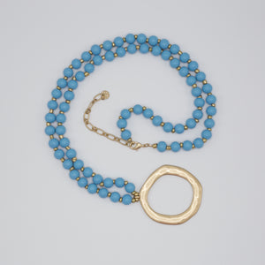 Hailey Necklace-The color on this necklace is BOLD and BEAUTIFUL! The Hailey Necklace consist of 74 blue wood beads, 77 gold beads, 1 gold asymmetrical circle charm, a lobster claw for fastening plus a 3 inch gold chain extender. That's a lot of necklace to add to a summer maxi dress and sandals! Show our new Arrivals!-East Coast She, South Carolina