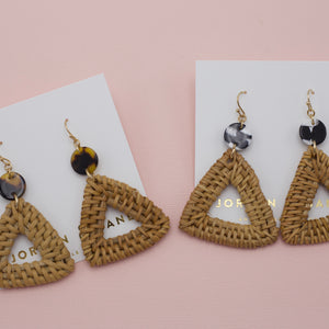 Wicker triangle jewelry earrings attached to black and white round acrylic circles on french hooks