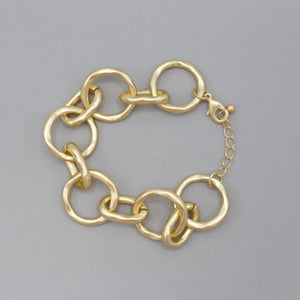 "Adele Bracelet-The Adele Bracelet is so stylish and versatile. This bracelet is made with chain linked circles of gold. You can wear it on casual days, work days or date night days. This bracelet has a lobster claw with adjustable extender. Gold Plated Chain link Lobster clasp 1-inch extender. One size | 1 1/4"" Long. New Arrivals!-East Coast She, South Carolina"