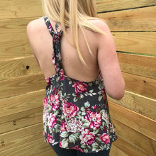 Colors of gray pink green and white floral tank top with lace up detail in back